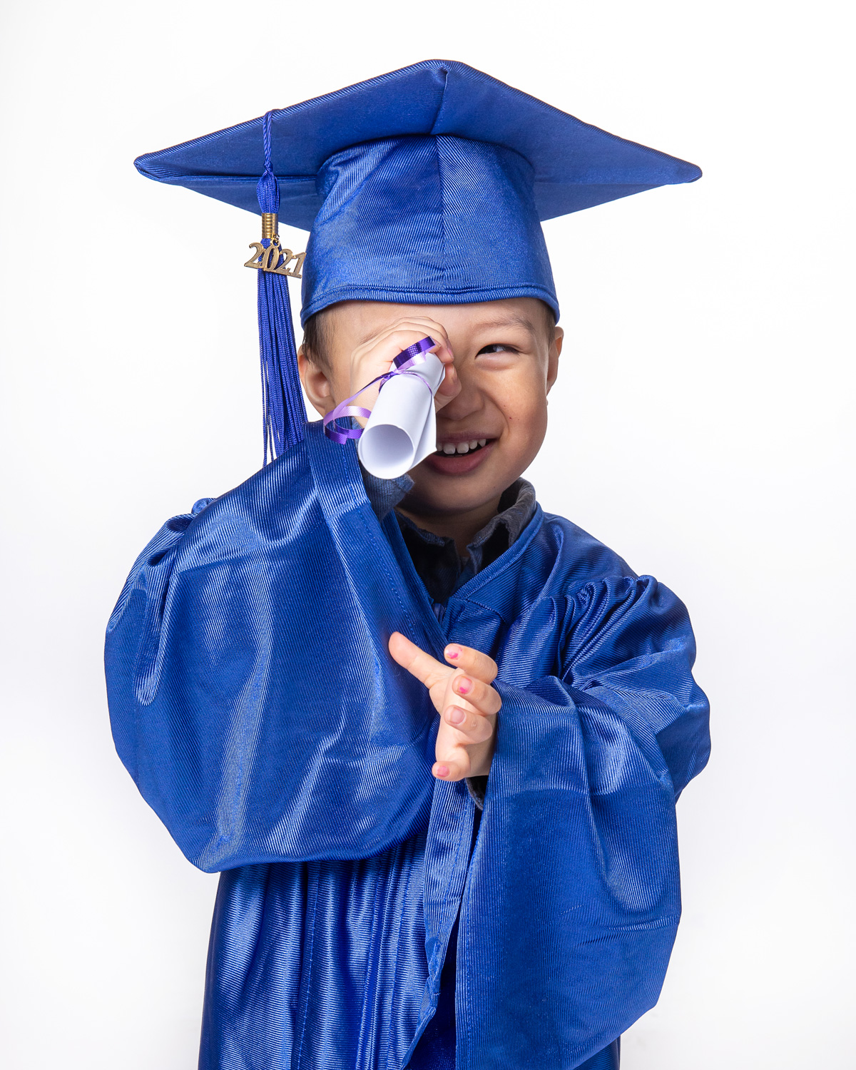 Little boy in cap and gown