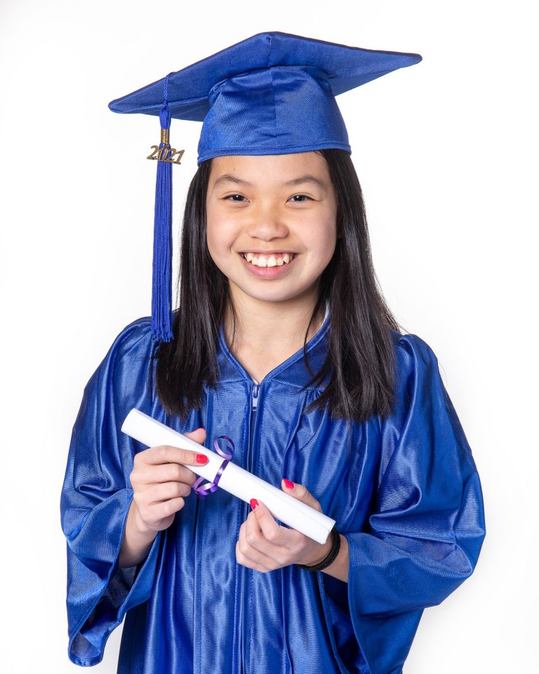 Grade 6 girl in cap and gown
